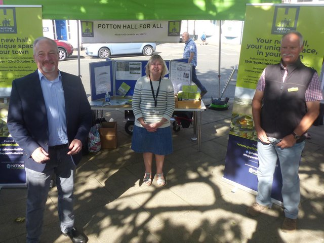 Left to right: Richard Fuller, MP stands with Potton Hall for All charity chair Liz Smith and Potton Town Council Councillor Jonathan Price-Williams, photographed at the Potton Seasonal Market on Saturday.