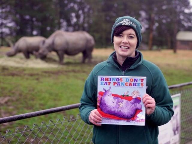 ZSL Whipsnade Zoo's Catriona Hickey reads Rhinos Don't Eat Pancakes by Anna Kemp (C) ZSL Matt Worthington
