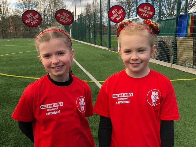 Robert Bloomfield Academy Year 5 pupils Faith, left, and Emily pictured at their sponsored cartwheel challenge, which took place at the school's multi use games area.