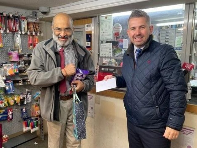 Postmaster Dilip Karavadra with Paul Mead, Post Office Area Manager