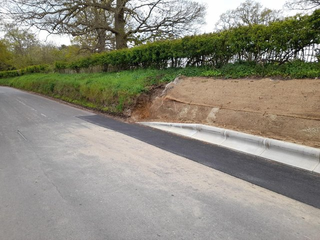 The kerb along the middle section of the Warden Road stone bank.
