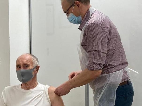 A vaccine being administered