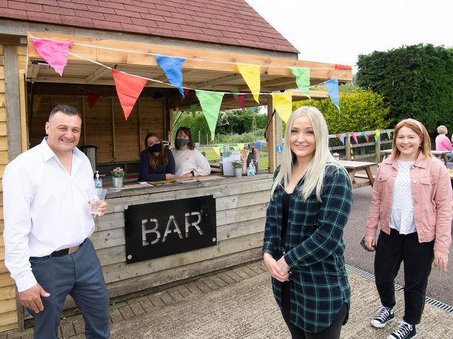 Mike Aldridge, Vice Chairman of Blunham Playing Fields Association, with Alice McGilley, Social Secretary, and Jo Ashpole, another Trustee, with bar staff Christina Burt and Becca Earl.
