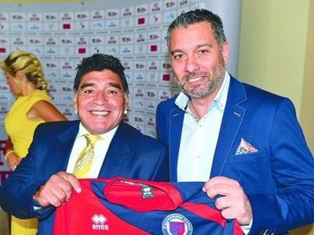 Diego Maradona was happy to pose with the Biggleswade United shirt