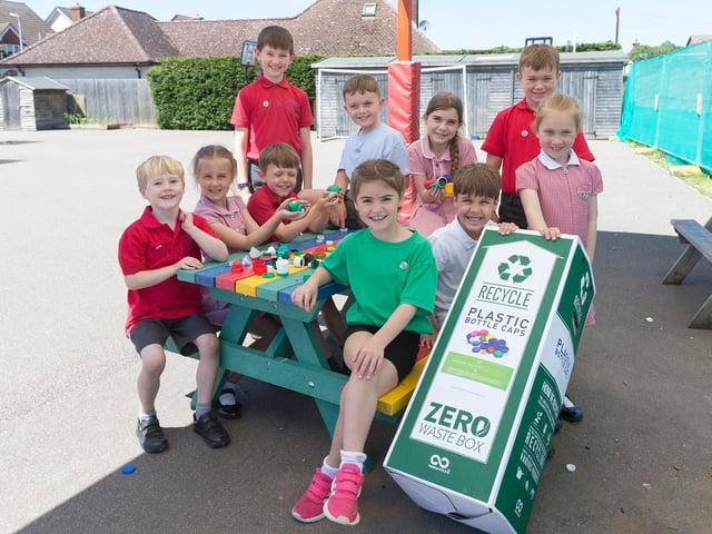 Children at the school enjoying the new bench