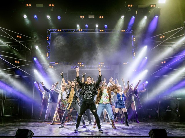 The show is 'something akin to a full-blown rock concert'